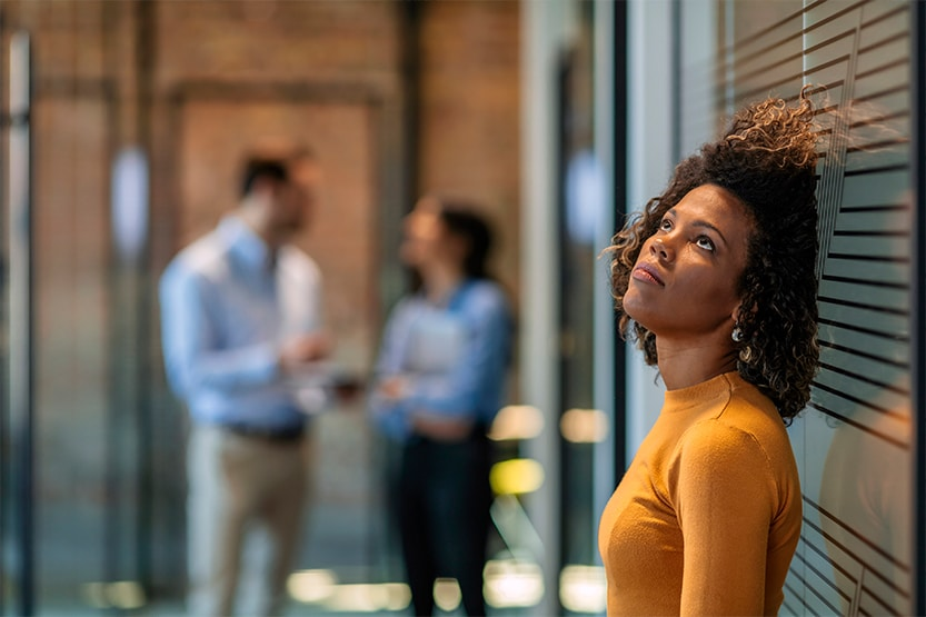 female employee dealing with redundancy | How does redundancy work - IRIS