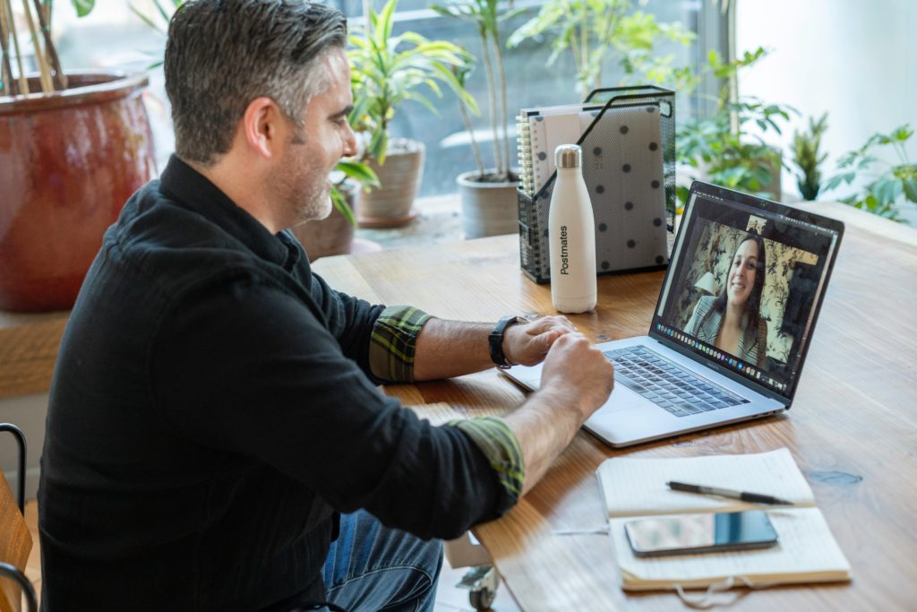 Colleagues working from home as part of flexible working arrangements - How to manage flexible working in 2021 and beyond | IRIS