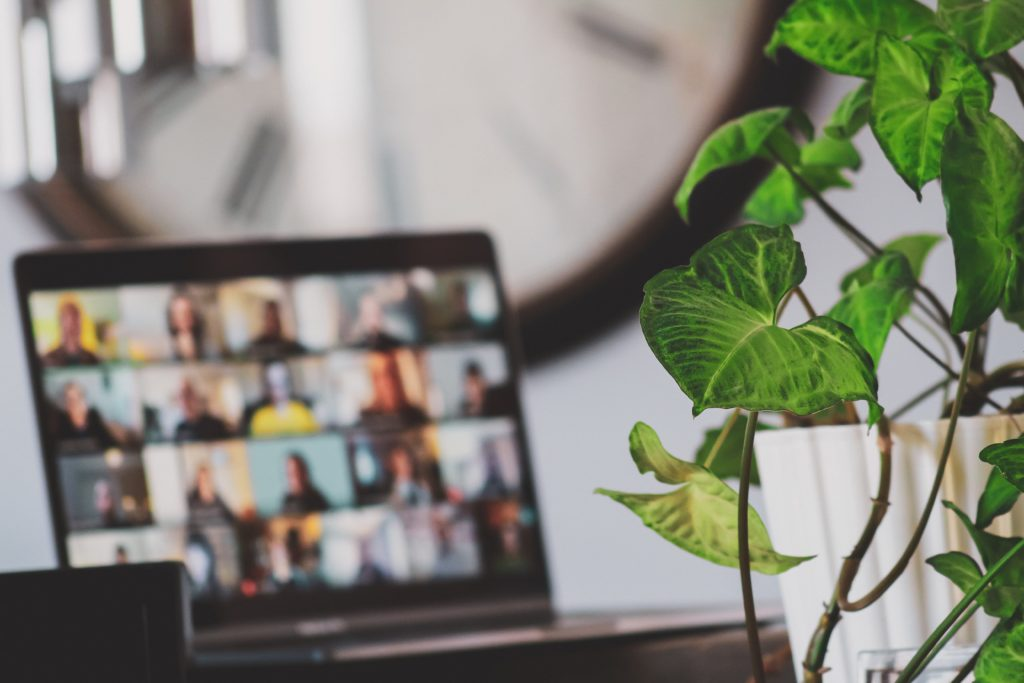 A whole team using flexible working effectively and maintaining strong communication via digital tools - How to manage flexible working in 2021 and beyond | IRIS